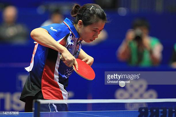 Kim Kyung Ah of South Korea serves during her matrch against Wang Yuegu of Singapore during the LIEBHERR table tennis team world cup 2012...