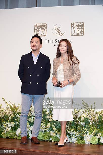 Kim KyuSik and Kim SeA attend the Bae SooBin Wedding at the Shilla hotel on September 14 2013 in Seoul South Korea