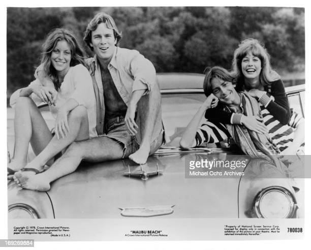 Kim Lankford James Daughton Michael Luther and Susan Player on top of car in publicity portrait for the film 'Malibu Beach' 1978
