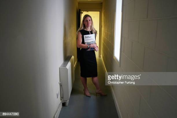 Kim Leadbeater, the sister of the late Jo Cox MP, poses with the report of the Jo Cox Commission on December 15, 2017 in Batley, England. The...