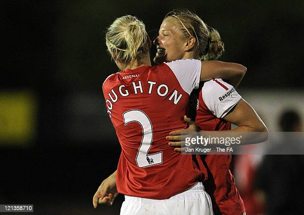 Kim Little and Stephanie Houghton of Arsenal celebrate their team's win at the close of the FA Women's Super League match between Arsenal Ladies FC...
