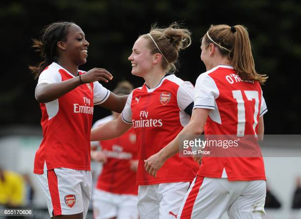Kim Little celebrates scoring a goal for Arsenal with Heather O'Reilly and Danielle Carter during the match between Arsenal Ladies and Tottenham...