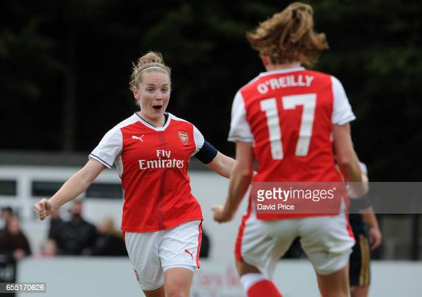 Kim Little celebrates scoring a goal for Arsenal with Heather O'Reilly during the match between Arsenal Ladies and Tottenham Hotspur Ladies on March...