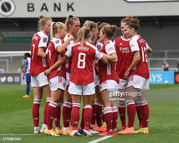 Kim Little celebrates scoring a goal for Arsenal with her team mates during the match between Arsenal Women and Reading Women at Meadow Park on...