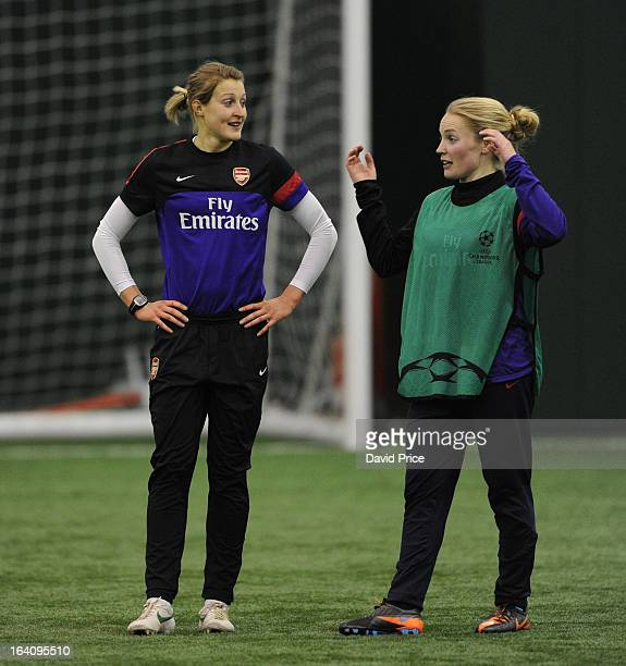 Kim Little chats with Ellen White of Arsenal Ladies during an Arsenal Ladies Training Session at Arsenal Training Ground on March 19 2013 in St...