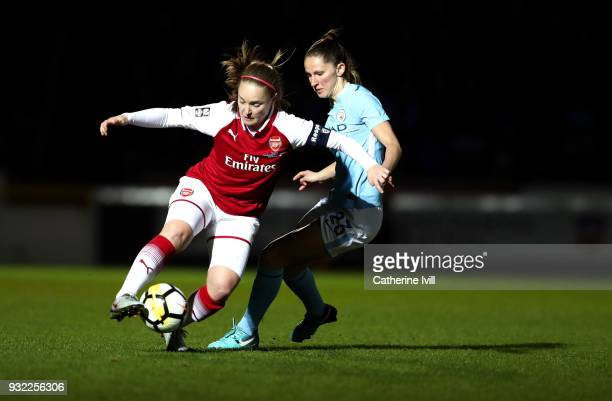 Kim Little of Arsenal is challenged by Abbie McManus of Manchester City during the WSL Continental Cup Final between Arsenal Women and Manchester...