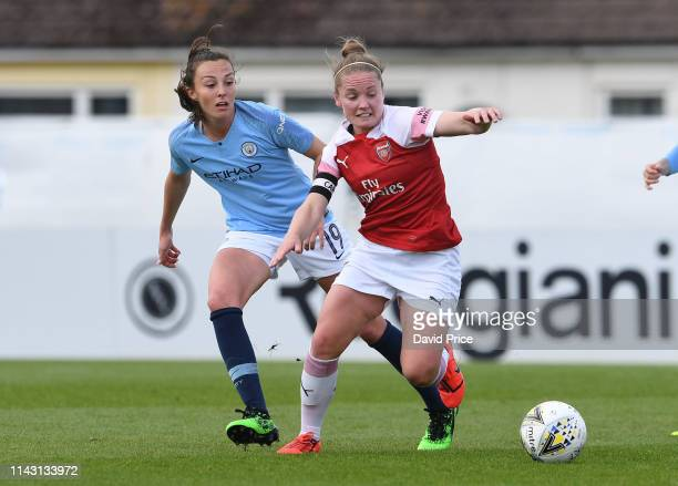Kim Little of Arsenal is challenged by Caroline Weir of Man City during the match between Arsenal Women and Manchester City Women at Meadow Park on...
