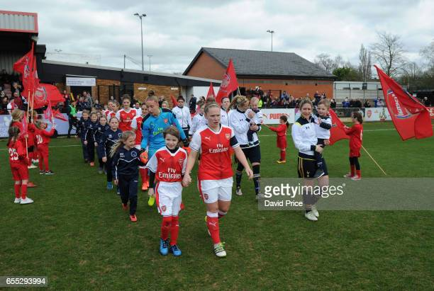 Kim Little of Arsenal Ladies and Jenna Schillachi of Tottenham Hotspur Ladies lead out their teams before the match between Arsenal Ladies and...