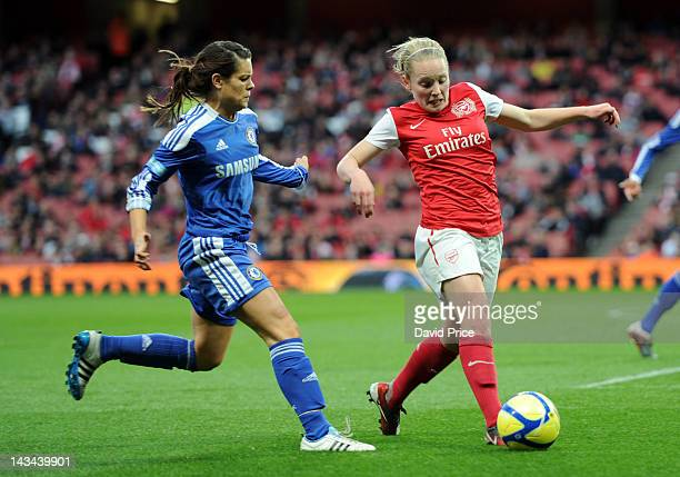 Kim Little of Arsenal Ladies takes on Claire Rafferty of Chelsea during the match between Arsenal Ladies and Chelsea at Emirates Stadium on April 26...