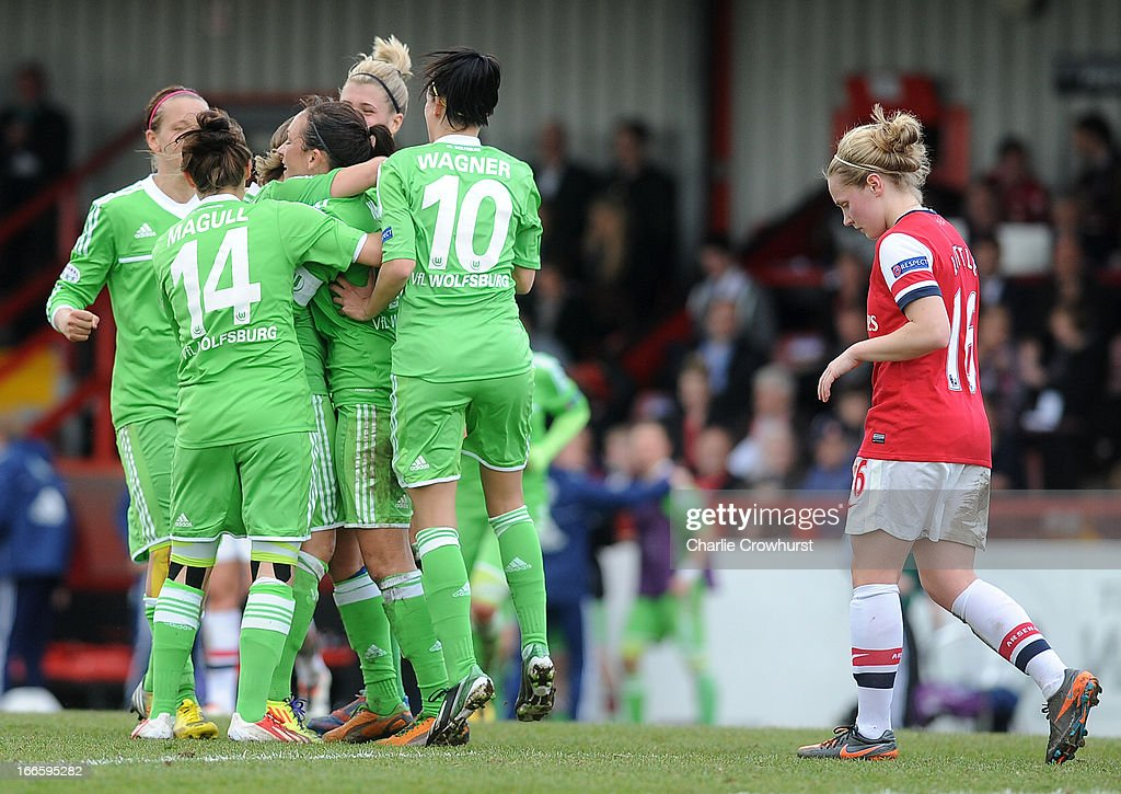 Kim Little of Arsenal looks on dejected as the Wolfsburg players celebrate after their team-mate Martina Muller scored a goal during the UEFA Women's Champions League Semi Final First Leg match between Arsenal Ladies and VFL Wolfsburg at Meadow Park on April 14, 2013 in Borehamwood, England.