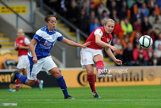 Kim Little of Arsenal passes under pressure from Jo Potter of Birmingham during the FA WSL Continental Cup Final between Birmingham City Ladies FC...