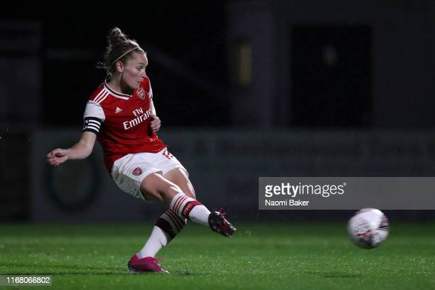 Kim Little of Arsenal scores her sides second goal from the penalty spot during the Pre Season Friendly match between Arsenal and Barcelona at Meadow...