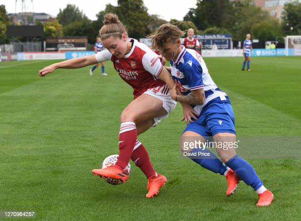 Kim Little of Arsenal shields the ball from Jessica Fishlock of Reading during the match between Arsenal Women and Reading Women at Meadow Park on...