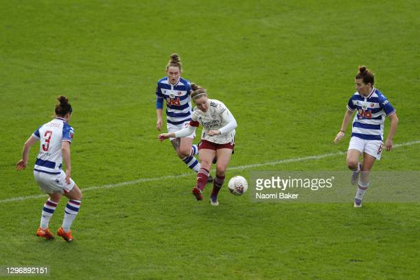 Kim Little of Arsenal shoots under pressure from Emma Mitchell, Rachel Rowe and Angharad James of Reading during the Barclays FA Women's Super League...
