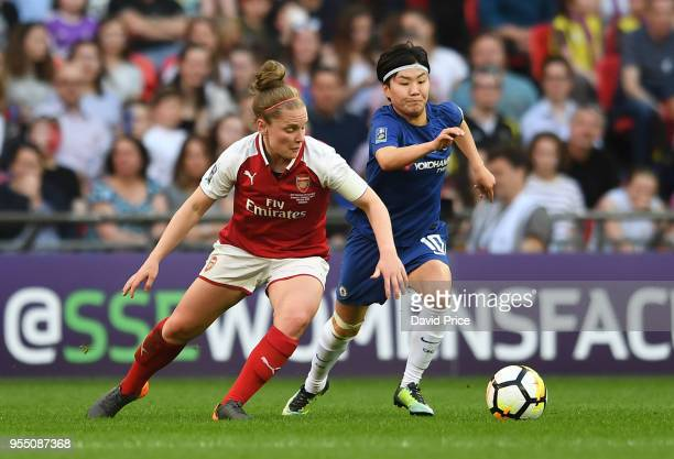 Kim Little of Arsenal takes on Ji Soyun of Chelsea during the match between Arsenal Women and Chelsea Ladies at Wembley Stadium on May 5 2018 in...