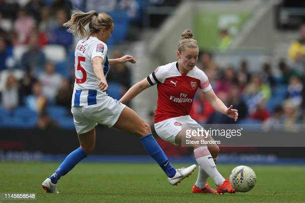 Kim Little of Arsenal Women breaks away from Kayleigh Green of Brighton and Hove Albion Women during the WSL match between Brighton and Hove Albion...