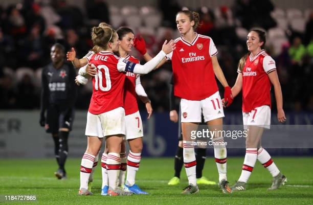 Kim Little of Arsenal Women celebrates after scoring her sides second goal with Danielle van de Donk and Vivianne Miedema during the UEFA Women's...