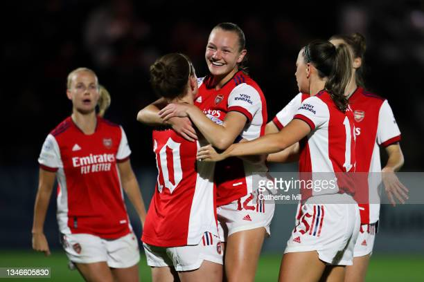 Kim Little of Arsenal Women FC celebrateswith her team mate Frida Maanum after scoring his team's first goal from the penalty spot during the UEFA...