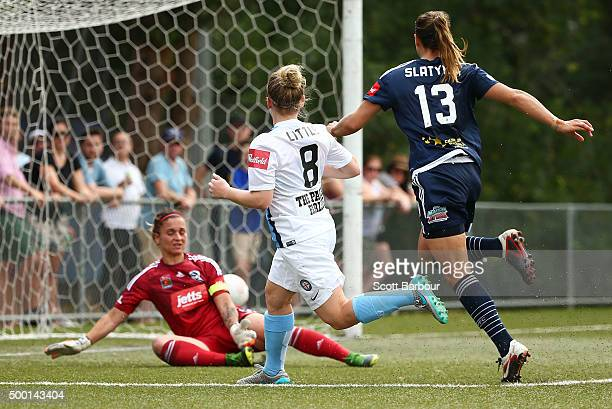 Kim Little of City beats Victory goalkeeper Melissa Barbieri to score a goal during the round eight WLeague match between the Melbourne Victory and...