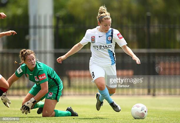 Kim Little of City FC beats goalkeeper Teagan Micah of the Wanderers to score the first goal during the round 12 WLeague match between Melbourne City...