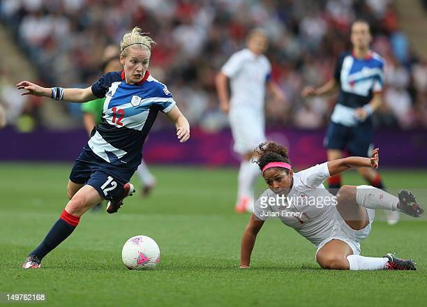 Kim Little of Great Britain goes past Desiree Scott of Canada during the Women's Football Quarter Final match between Great Britain and Canada on Day...