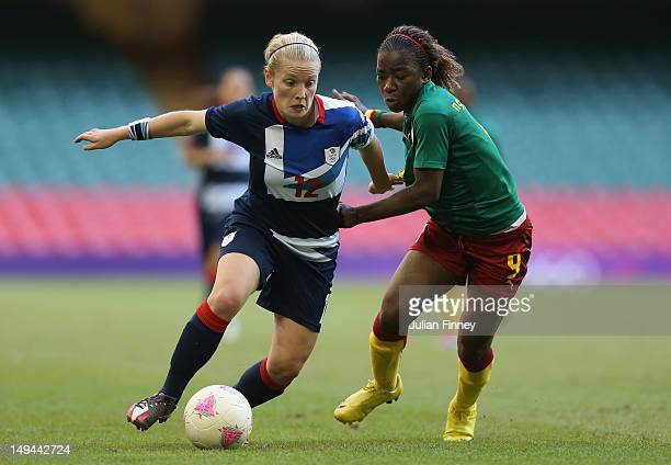 Kim Little of Great Britain goes past Madeleine Ngono Mani of Cameroon during the Women's Football first round Group E Match between Great Britain...