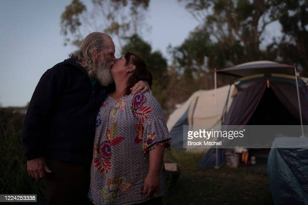 Kim Logridge and Narelle Story are pictured on Kim's Qaamaa property on May 08 2020 near Cobargo Australia Kim lost part of his home and continues to...