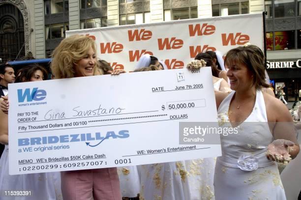 Women's Entertainment presents the $50000 check to winner Gina Savastano of Manhattan