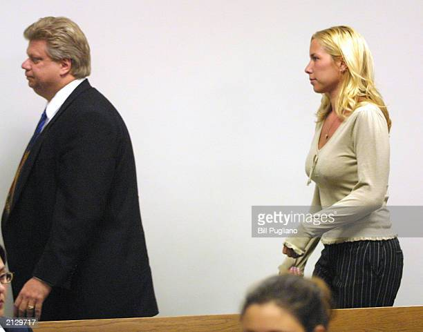 Kim Mathers Eminem's exwife leaves the courtroom of St Clair Shores District Court July 1 2003 in St Clair Shores Michigan after her arraignment...
