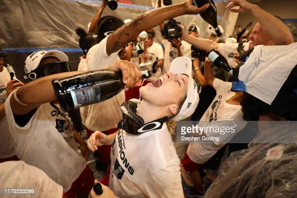 Kim Mestdagh of the Washington Mystics celebrates in the locker room after winning the 2019 WNBA Finals against the Connecticut Sun during Game Five...