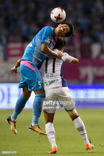 Kim Min Hyeok of Sagan Tosu and Hwang Ui Jo of Gamba Osaka compete for the ball during the JLeague J1 match between Sagan Tosu and Gamba Osaka at...