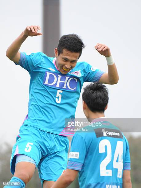 Kim Min Hyeok of Sagan Tosu celebrates the first goal by Daichi Kamada during the JLeague match between Kashiwa Reysol and Sagan Tosu at Hitachi...