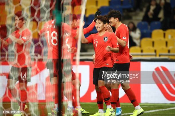 Kim Min-jae of South Korea celebrates with his teammates after scores a first goal during the EAFF E-1 Football Championship match between South...