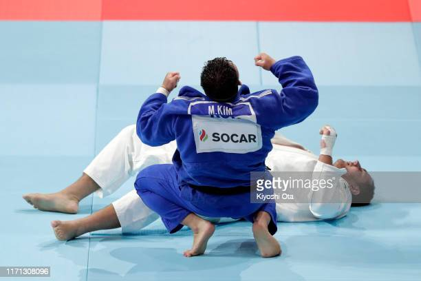 Kim Minjong of South Korea celebrates his victory over Rafael Silve of Brazil in the Men's +100kg bronze medal bout on day seven of the World Judo...