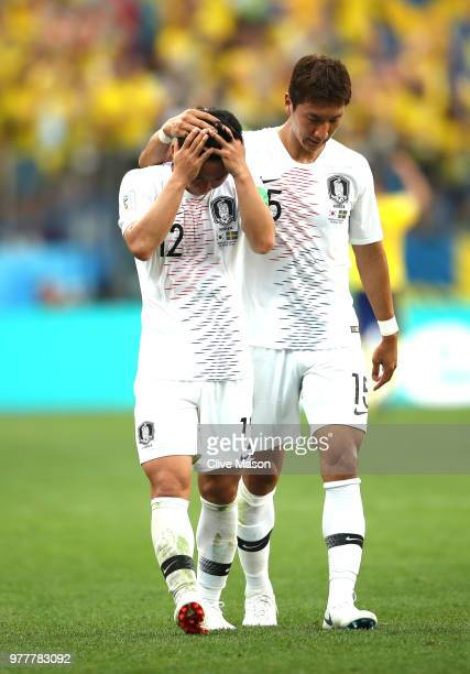 Kim Min-Woo and team mate Jung Woo-Young of Korea Republic look dejected following the 2018 FIFA World Cup Russia group F match between Sweden and...