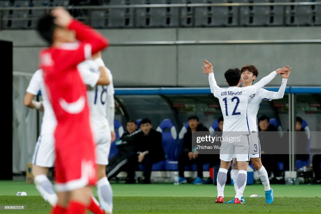 Kim Minwoo of South Korea celebrates with his teammates during the EAFF E-1 Men's Football Championship match between North Korea and South Korea at Ajinomoto Stadium on December 12, 2017 in Chofu, Tokyo, Japan.