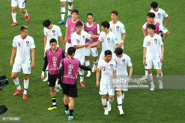 Kim Min-Woo of South Korea is consoled by his teammates after his foul gave away the winning penalty during the 2018 FIFA World Cup Russia group F...
