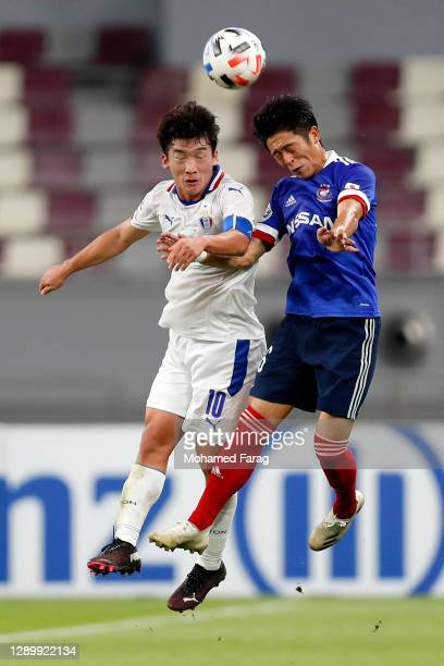 Kim Min-Woo of Suwon Samsung and Ryo Takano of Yokohama F.Marinos compete for the ball during the AFC Champions League Round of 16 match between...