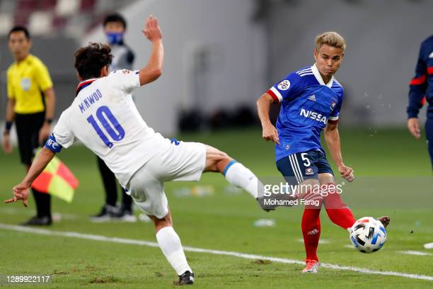 Kim Min-Woo of Suwon Samsung and Theerathon Bunmathan of Yokohama F.Marinos compete for the ball during the AFC Champions League Round of 16 match...
