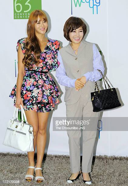 Kim MiYoun and Hyun Sook attend Jang YoonJung and Do KyungWan Wedding at 63 building convention center on June 28 2013 in Seoul South Korea