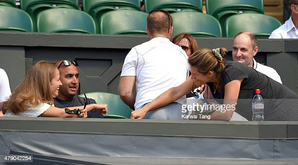 Kim Murray and Amelie Mauresmo attend the Mikhail Kukushkin v Andy Murray match on day two of the Wimbledon Tennis Championships at Wimbledon on June...