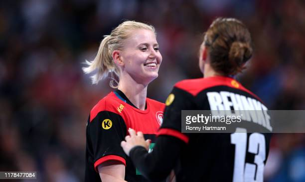 Kim Naidzinavicius and Julia Behnke of Germany celebrate during the friendly match as part of the 'Tag des Handballs' between Germany Women's and...