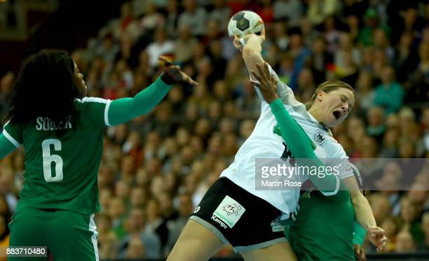 Kim Naidzinavicius of Germany challenges of Yvette Yuoh of Cameroon during the IHF Women's Handball World Championship group D match between Germany...