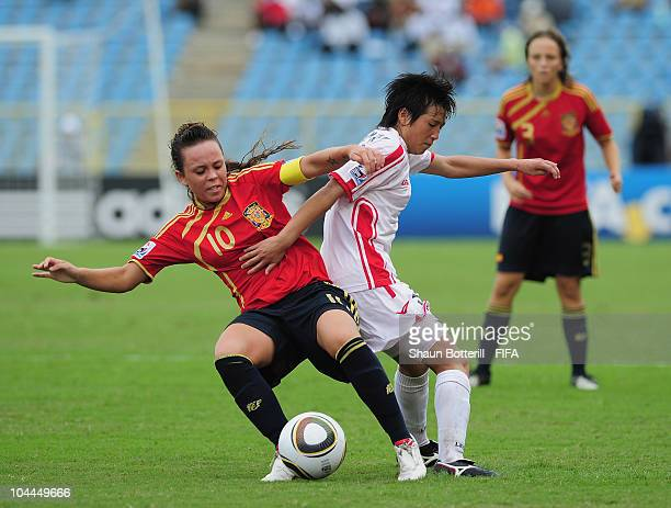Kim Nam Hui of North Korea is challenged by Amanda Sampedro of Spain during the FIFA U17 Women's World Cup 3rd Place Playoff match between Spain and...
