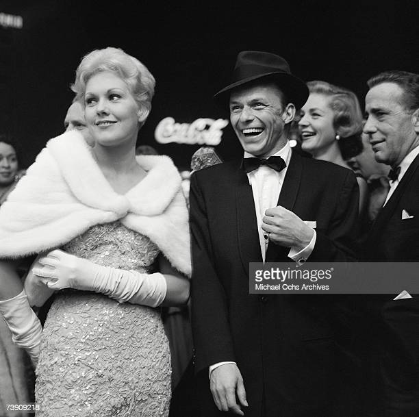 """Kim Novack, Frank Sinatra, Lauren Bacall and Humphrey Bogart attend the premier of """"The Desperate Hours"""" on October 10, 1955 in Los Angeles,..."""