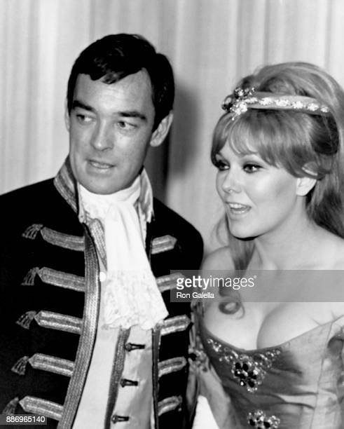 Kim Novak and Richard Johnson attend Moll Flanders Ball on May 7 1965 at the Waldorf Astoria Hotel in New York City