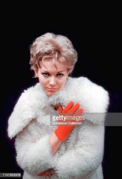 Kim Novak portrait session wearing a fur coat at home November 26, 1958.