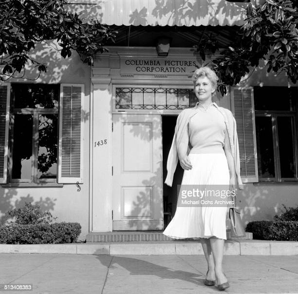 Kim Novak poses for a portrait leaving Columbia Pictures in Los AngelesCA