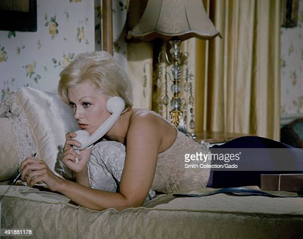 Kim Novak speaking on the phone, in a color movie still, 1960.