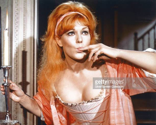 Kim Novak US actress with long red hair and her finger in her mouth in a publicity still isuued for the film 'The Amorous Adventures of Moll...